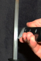 Using the correct angle you can see that the contact is at the edge of the knife.