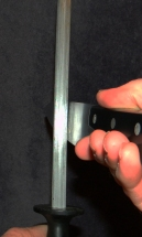When you have too little you are scratching the side of the blade and not sharpening the edge