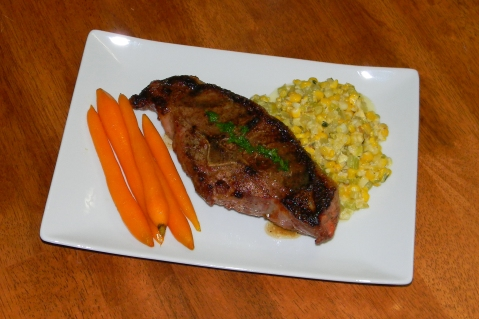 Double Lamb Chops, Young carrots, and corn maque choux